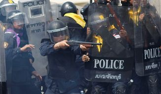 Gunbattles broke out Tuesday as hundreds of riot police made their strongest attempt to clear protest sites around Thailand's capital, killing several people and injuring scores of others. Protesters are angry about the government's failure to pay farmers. (Associated Press)