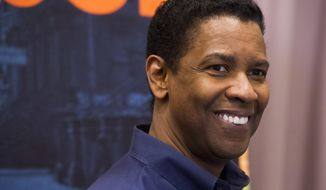 "Denzel Washington appears at a press opportunity for the upcoming Broadway production of ""A Raisin in the Sun"" on Tuesday, Feb. 18, 2014 in New York. (Photo by Charles Sykes/Invision/AP)"