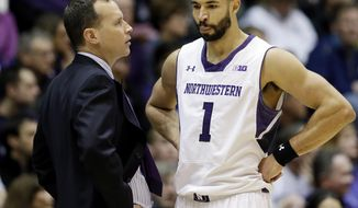 Northwestern head coach Chris Collins, left, talks to guard Drew Crawford during the first half of an NCAA college basketball game against Minnesota in Evanston, Ill., Sunday, Feb. 16, 2014. Minnesota won 54-48. (AP Photo/Nam Y. Huh)