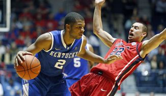Kentucky guard Aaron Harrison (2) pushes past Mississippi guard Marshall Henderson (22) during the second half of an NCAA college basketball game in Oxford, Miss., Tuesday, Feb. 18, 2014. Kentucky won 84-70. (AP Photo/Rogelio V. Solis)