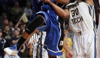 Duke guard Rasheed Sulaimon (14) is fouled as he drives against Georgia Tech guard Corey Heyward (30) in the first half of an NCAA college basketball game, Tuesday, Feb. 18, 2014, in Atlanta. (AP Photo/John Bazemore)