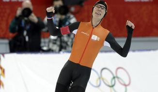 Gold medallist Jorrit Bergsma of the Netherlands celebrates after setting a new world record in the men's 10,000-meter speedskating race at the Adler Arena Skating Center during the 2014 Winter Olympics in Sochi, Russia, Tuesday, Feb. 18, 2014. (AP Photo/Matt Dunham)