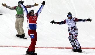 France's Pierre Vaultier, second left, celebrates taking the gold medal ahead of silver medalist Nikolai Olyunin of Russia, right, and bronze medalist Alex Deibold of the United States in the men's snowboard cross final at the Rosa Khutor Extreme Park, at the 2014 Winter Olympics, Tuesday, Feb. 18, 2014, in Krasnaya Polyana, Russia. (AP Photo/Andy Wong)