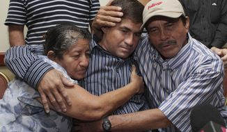 Jose Salvador Alvarenga, a fisherman who says he drifted at sea for more than a year surviving on raw fish, turtles and bird blood, is embraced by his parents, Ricardo Orellana, right, and Maria Julia Alvarenga during a news conference in San Salvador, El Salvador, Tuesday, Feb. 18, 2014.  Alvarenga, 37, underwent a battery of tests after returning home from the Marshall Islands, where he showed up after what he has described as 6,500-mile (10,500-kilometer) journey from Mexico that began when his small fishing boat was thrown off course by bad weather. Alvarenga said he wouldn't be returning to his hometown of Garita Palmera, but he did not say where he was headed. (AP Photo/Salvador Melendez)