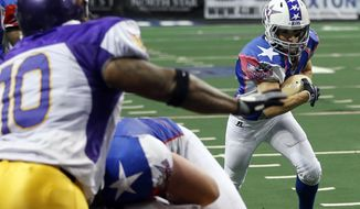 Texas Revolution's Jennifer Welter (47) runs up the field as the North Texas Crunch defense closes in on her near the goal line during the second half of an Indoor Football League game Saturday, Feb. 15, 2014, in Allen, Texas. (AP Photo/The Dallas Morning News, Vernon Bryant) MANDATORY CREDIT; MAGS OUT; TV OUT; INTERNET USE BY AP MEMBERS ONLY; NO SALES