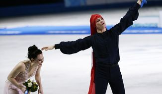 Tessa Virtue and Scott Moir of Canada celebrate placing second in the ice dance free dance figure skating finals at the Iceberg Skating Palace during the 2014 Winter Olympics, Monday, Feb. 17, 2014, in Sochi, Russia. (AP Photo/Bernat Armangue)