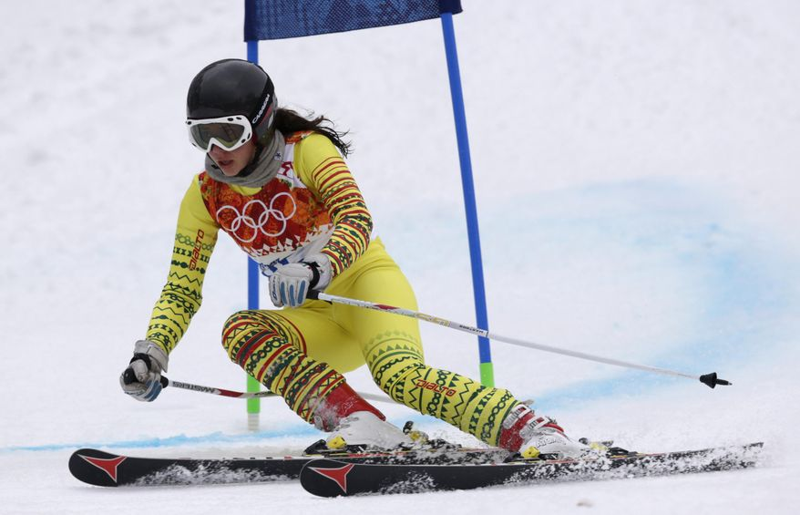 Togo's Alessia Afi Dipol passes a gate in the first run of the women's giant slalom at the Sochi 2014 Winter Olympics, Tuesday, Feb. 18, 2014, in Krasnaya Polyana, Russia. (AP Photo/Charles Krupa)