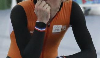Bob de Jong of the Netherlands reflects after his 10,000-meter speedskating race at the Adler Arena Skating Center during the 2014 Winter Olympics in Sochi, Russia, Tuesday, Feb. 18, 2014. (AP Photo/David J. Phillip )