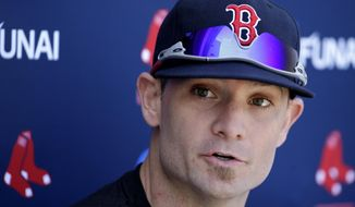 Boston Red Sox left fielder Jonny Gomes speaks with reporters during spring training baseball practice Tuesday, Feb. 18, 2014, in Fort Myers, Fla. (AP Photo/Steven Senne)