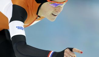Silver medallist Ireen Wust of the Netherlands competes in the women's 1,500-meter speedskating race at the Adler Arena Skating Center during the 2014 Winter Olympics in Sochi, Russia, Sunday, Feb. 16, 2014. (AP Photo/Patrick Semansky)