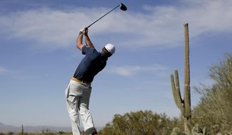 Graeme McDowell watches his tee shot on the second hole during a practice round at the Match Play Championship golf tournament on Tuesday, Feb. 18, 2014 in Marana, Ariz. (AP Photo/Chris Carlson)