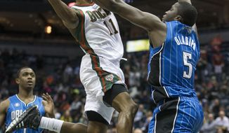 Milwaukee Bucks' Brandon Knight shoots over Orlando Magic's Victor Oladipo during the second half of an NBA basketball game Tuesday, Feb. 18, 2014, in Milwaukee. (AP Photo/Tom Lynn)