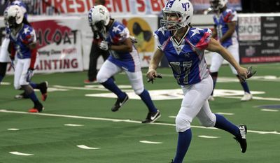 Texas Revolution's Jennifer Welter (47) runs during warmups before an Indoor Football League game against the North Texas Crunch on Saturday, Feb. 15, 2014, in Allen, Texas. (AP Photo/The Dallas Morning News, Vernon Bryant) MANDATORY CREDIT; MAGS OUT; TV OUT; INTERNET USE BY AP MEMBERS ONLY; NO SALES