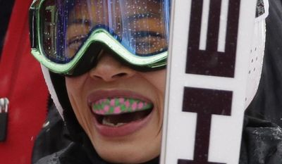 Violinst Vanessa Mae, starting under her father's name as Vanessa Vanakorn for Thailand, smiles after competing in the first run of the women's giant slalom at the Sochi 2014 Winter Olympics, Tuesday, Feb. 18, 2014, in Krasnaya Polyana, Russia. (AP Photo/Gero Breloer)