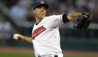 FILE - In this Sept. 24, 2013 file photo, Cleveland Indians starting pitcher Ubaldo Jimenez delivers in the first inning of a baseball game against the Chicago White Sox in Cleveland. A person familiar with the situation said Monday, Feb. 17, 2014, free-agent pitcher Ubaldo Jimenez and the Baltimore Orioles have agreed to a contract, pending a physical. (AP Photo/Tony Dejak, File)
