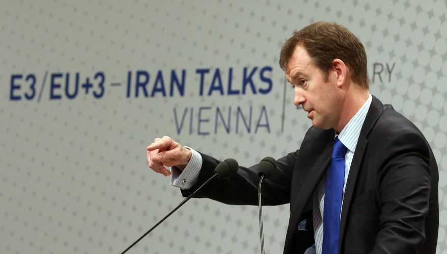 Michael Mann, spokesperson for EU foreign policy chief Catherine Ashton spekes to press during closed-door nuclear talks in Vienna, Austria, Tuesday, Feb. 18, 2014. Iran and six world powers are back at the negotiating table eager to come to terms on a comprehensive nuclear deal but deeply divided on what it should look like. The two sides began meeting Tuesday in attempts to build on a first-step accord that temporarily curbs Tehran's nuclear activities in exchange for some sanctions relief. (AP Photo/Ronald Zak)