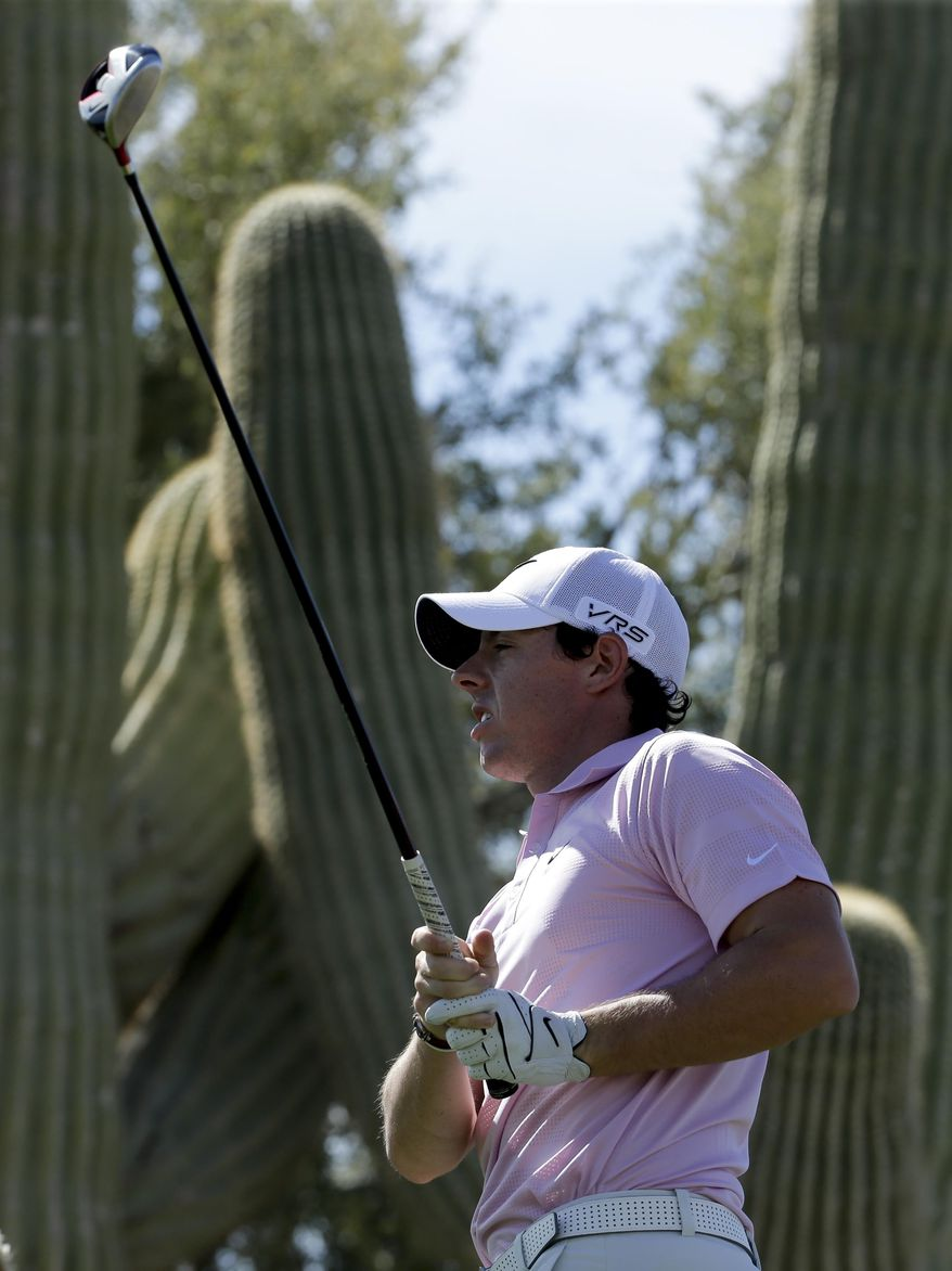 Rory McIlroy watches his tee shot on the 18th hole during a practice round for the Match Play Championship golf tournament on Tuesday, Feb. 18, 2014 in Marana, Ariz. (AP Photo/Chris Carlson)
