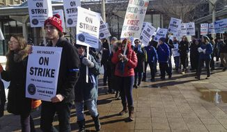 University of Illinois at Chicago faculty members hold a kick-off rally before a two-day strike to protest low wages as contract negotiations continue Tuesday, Feb. 18, 2014, in Chicago.  (AP Photo/Sun-Times Media, Stefano Esposito)  MANDATORY CREDIT, MAGS OUT, NO SALES