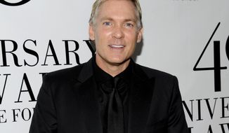 "FILE - This May 21, 2012 file photo shows  Sam Champion at the FiFi Fragrance Awards at Alice Tully Hall in New York. Champion's new Weather Channel morning program, ""America's Morning Headquarters with Sam Champion,"" or, for short, ""AMHQ,"" which debuts March 17 will return him to the a.m. scene where he hailed as weather anchor on ABC's New York-based ""Good Morning America."" (AP Photo/Evan Agostini, file)"