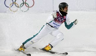 Silver medal winner David Morris of Australia celebrates after his final jump during men's freestyle skiing aerials at the Rosa Khutor Extreme Park, at the 2014 Winter Olympics, Monday, Feb. 17, 2014, in Krasnaya Polyana, Russia. (AP Photo/Andy Wong)