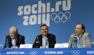 NHL Players' Association Executive Director Don Fehr, left, International Ice Hockey Federation President Rene Fasel, center, and NHL Commissioner Gary Bettman, right, answer questions at a news conference at the 2014 Winter Olympics, Tuesday, Feb. 18, 2014, in Sochi, Russia. (AP Photo/Mark Humphrey)