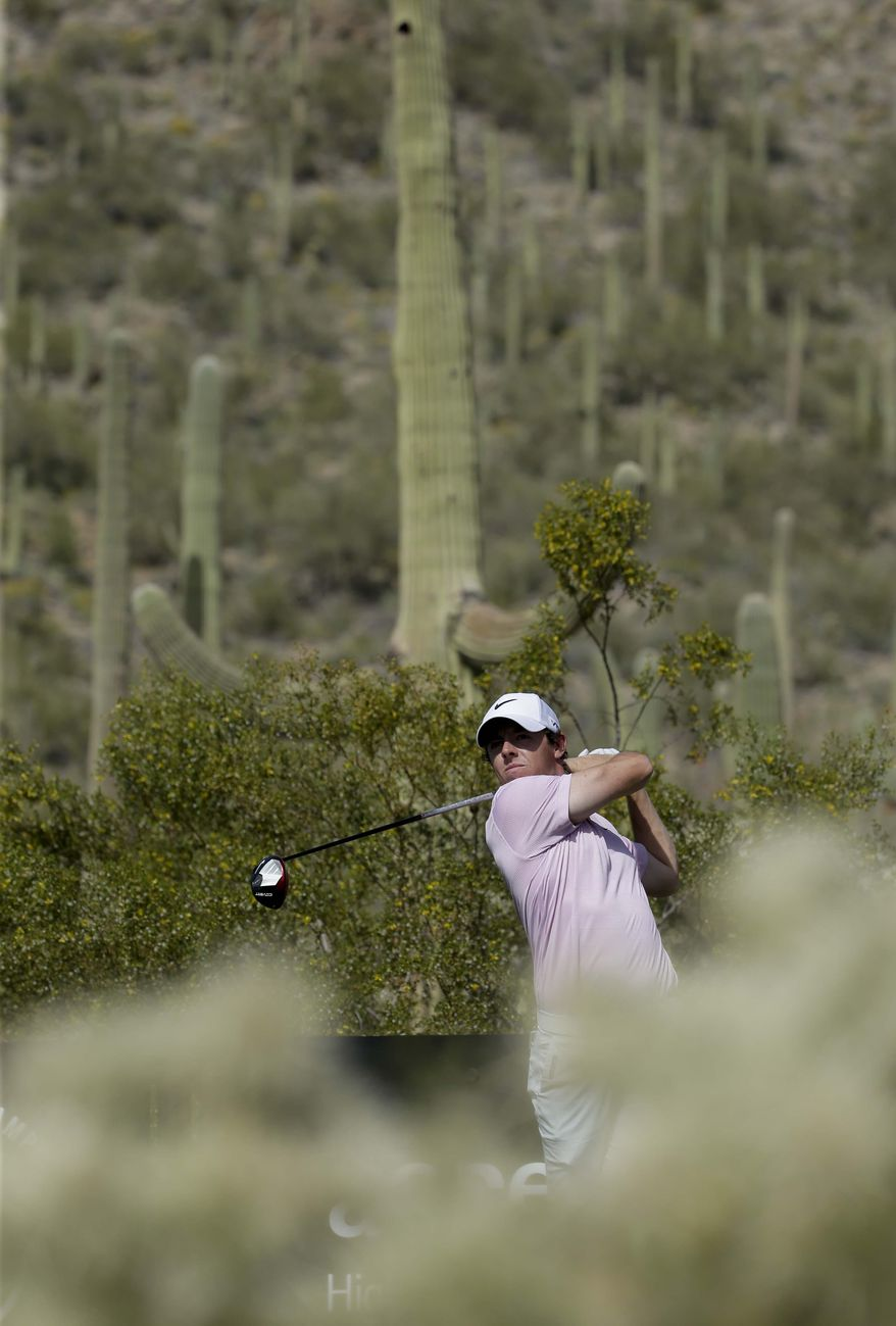 Rory McIlroy, of Northern Ireland, watches his tee shot during a practice round for the Match Play Championship golf tournament Tuesday, Feb. 18, 2014, in Marana, Ariz. (AP Photo/Chris Carlson)