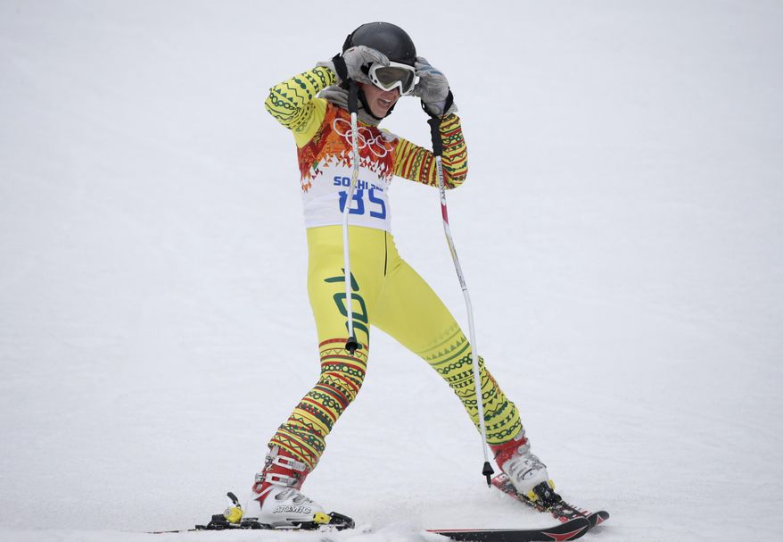 Togo's Alessia Afi Dipol rests after completing the first run in the women's giant slalom at the Sochi 2014 Winter Olympics, Tuesday, Feb. 18, 2014, in Krasnaya Polyana, Russia. (AP Photo/Gero Breloer)