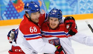 Czech Republic forward Roman Cervenka, right, celebrates his goal with forward Jaromir Jagr during the first period of the 2014 Winter Olympics men's ice hockey game against Slovakia at Shayba Arena, Tuesday, Feb. 18, 2014, in Sochi, Russia. (AP Photo/Petr David Josek)