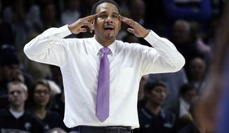 Providence head coach Ed Cooley instructs from the bench during overtime of an NCAA basketball game against Villanova in Providence, R.I., Tuesday, Feb. 18, 2014. Villanova won 82-79 in double overtime. (AP Photo/Elise Amendola)