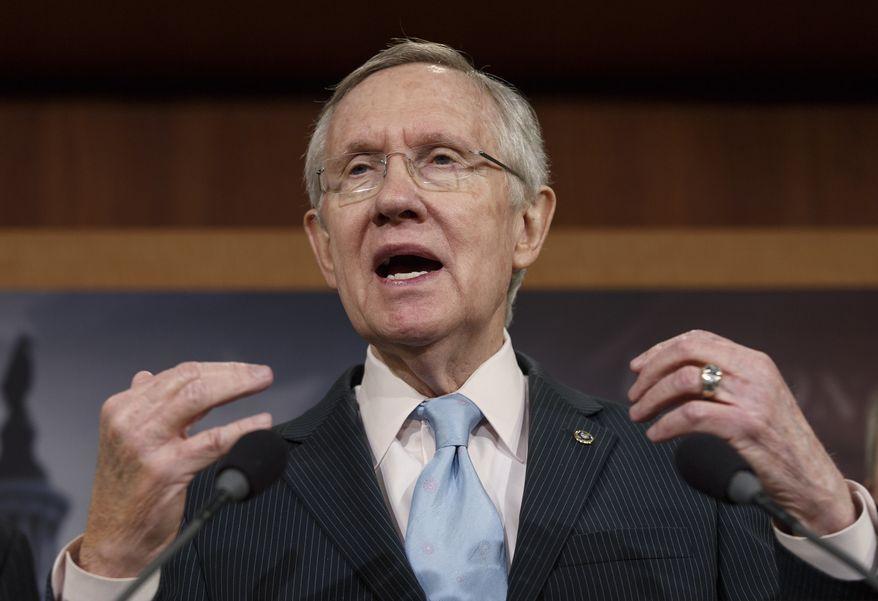 ** FILE ** In this Feb. 6, 2014, file photo, Senate Majority Leader Harry Reid, D-Nev., speaks on Capitol Hill in Washington. (AP Photo/J. Scott Applewhite, File)