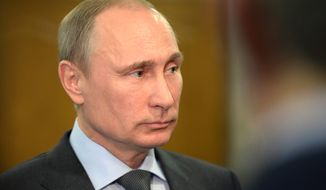 In this Monday, Feb. 17, 2014 photo, Russian President Vladimir Putin listens to questions during his visit to Cherepovets about 470 km ( 290 miles) north from Moscow. (AP Photo/RIA Novosti, Alexei Nikolsky, Presidential Press Service)