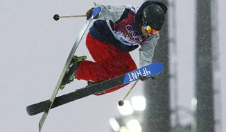 David Wise of the United States gets air during men's ski half pipe qualifying at the Rosa Khutor Extreme Park, at the 2014 Winter Olympics, Tuesday, Feb. 18, 2014, in Krasnaya Polyana, Russia. (AP Photo/Sergei Grits)