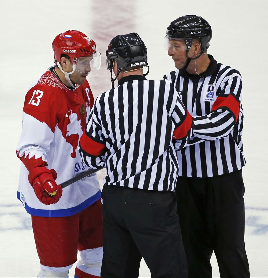 Russia forward Pavel Datsyuk talks with officials in the third period of a men's ice hockey game against the USA at the 2014 Winter Olympics, Saturday, Feb. 15, 2014, in Sochi, Russia. (AP Photo/Petr David Josek)