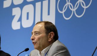 NHL Commissioner Gary Bettman answers questions about hockey issues at a news conference at the 2014 Winter Olympics, Tuesday, Feb. 18, 2014, in Sochi, Russia. (AP Photo/Mark Humphrey)