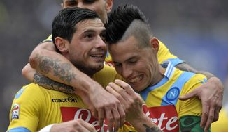 Napoli's Blerim Dzemaili of Switzerland, left, celebrates with his teammate Marek Hamsik of Slovakia, after scoring against Sassuolo during their Italian Serie A soccer match at Mapei stadium in Reggio Emilia, Italy, Sunday, Feb. 16, 2014. (AP Photo/Marco Vasini)