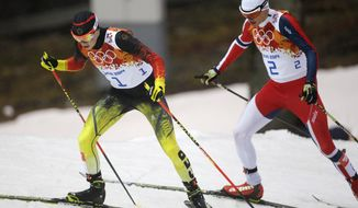 Germany's Eric Frenzel, left, and Norway's Haavard Klemetsen who led after the ski jumping ski during the Nordic combined individual Gundersen large hill competition at the 2014 Winter Olympics, Tuesday, Feb. 18, 2014, in Krasnaya Polyana, Russia. (AP Photo/Gregorio Borgia)