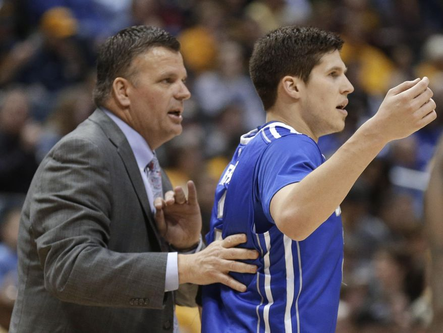Creighton's Doug McDermott, right, gets some instruction from coach and father Greg McDermott during the second half of an NCAA college basketball game against Marquette on Wednesday, Feb. 19, 2014, in Milwaukee. Creighton won 85-70. (AP Photo/Jeffrey Phelps)