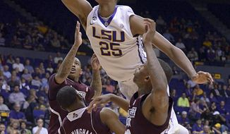 LSU's Jordan Mickey flies over Mississippi State players to score during an NCAA college basketball game Wednesday, Feb. 19, 2014, in Baton Rouge, La. (AP Photo/The Baton Rouge Advocate, Heather McClelland)