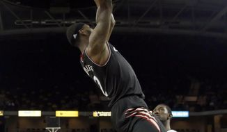 Cincinnati forward Titus Rubles (2) dunks the ball as Central Florida forward Tristan Spurlock (1) looks on during the second half of an NCAA basketball game, Wednesday, Feb. 19, 2014, in Orlando Fla. Cincinnati won 77-49. (AP Photo Reinhold Matay)