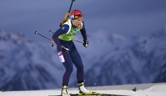 Norway's Tiril Eckhoff skis during the mixed biathlon relay at the 2014 Winter Olympics, Wednesday, Feb. 19, 2014, in Krasnaya Polyana, Russia. (AP Photo/Felipe Dana)