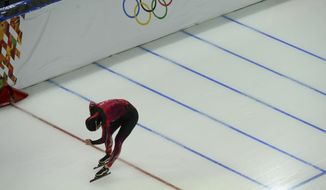 Fifth placed Claudia Pechstein of Germany crosses the finish line in the women's 5,000-meter speedskating race at the Adler Arena Skating Center during the 2014 Winter Olympics in Sochi, Russia, Wednesday, Feb. 19, 2014. (AP Photo/Antonin Thuillier, Pool)