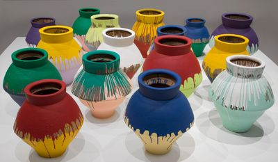 "In this undated photo made available by the Brooklyn Museum of Art, shows a series of 16 vases that are part of an installation by Chinese artist Wei Wei and currently on display at the Perez Art Museum in Miami. Artist Maximo Caminero broke one of the vases on Sunday, Feb. 16, 2014. Caminero told officers he broke the vase to protest the museum's lack of local artist displays and because ""the museum only displayed international artists' art,"" according to the affidavit. The Wei Wei exhibit was to be displayed next at the Brooklyn Museum of Art. (AP Photo/Brooklyn Museum of Art)"