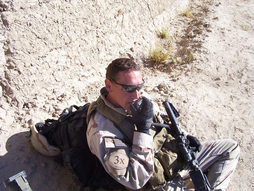 """Hands-on experience: Senior Warrant Officer Russton B. Kramer, who has fought in Afghanistan and was awarded the Silver Star for his bravery for action in Iraq, says of the Army's standard-issue M4 carbine, """"The reliability is not there."""""""