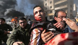 A wounded Lebanese man is carried from the site of an explosion in a suburb of Beirut on Wednesday. A blast in a Shiite district in southern Beirut killed several people Wednesday, security officials said. Twin suicide bombings killed at least six people. (Associated press)