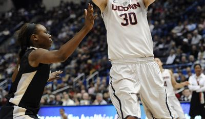 Connecticut's Breanna Stewart, right, looks to shoot over Central Florida's Stephanie Taylor, left, during the first half of an NCAA college basketball game, Wednesday, Feb. 19, 2014, in Hartford, Conn. (AP Photo/Jessica Hill)