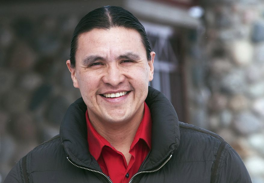 """In this Feb. 6, 2014 photo, Chase Iron Eyes, an attorney and American Indian activist on the Standing Rock Reservation, is seen in Fort Yates, N.D., where he talked about being less dependent on propane and finding alternative ways to heat houses on the reservation. The effort to raise $50,000 for a pilot project aimed at moving Standing Rock Reservation homes away from reliance on propane fuel has reached its goal in just a couple of weeks. Iron Eyes launched the """"Heating the Rez""""  effort that has drawn more than 1,150 donations from as far as Australia and Sweden. The money will outfit 20 homes with heat stoves that burn pellets made from natural materials.has spearheaded an effort (AP Photo/Kevin Cederstrom)"""