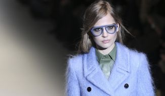 A model wears a creation for Gucci women's Fall-Winter 2014-15 collection, part of the Milan Fashion Week, unveiled in Milan, Italy, Wednesday, Feb. 19, 2014. (AP Photo/Antonio Calanni)
