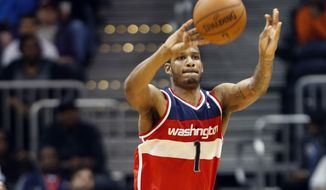 Washington Wizards forward Trevor Ariza (1) hits a 3-point basket from beyond half-court as the buzzer sounded to end the third quarter of an NBA basketball game against the Atlanta Hawks Wednesday, Feb. 19, 2014, in Atlanta. Washington won 114-97. (AP Photo/John Bazemore)