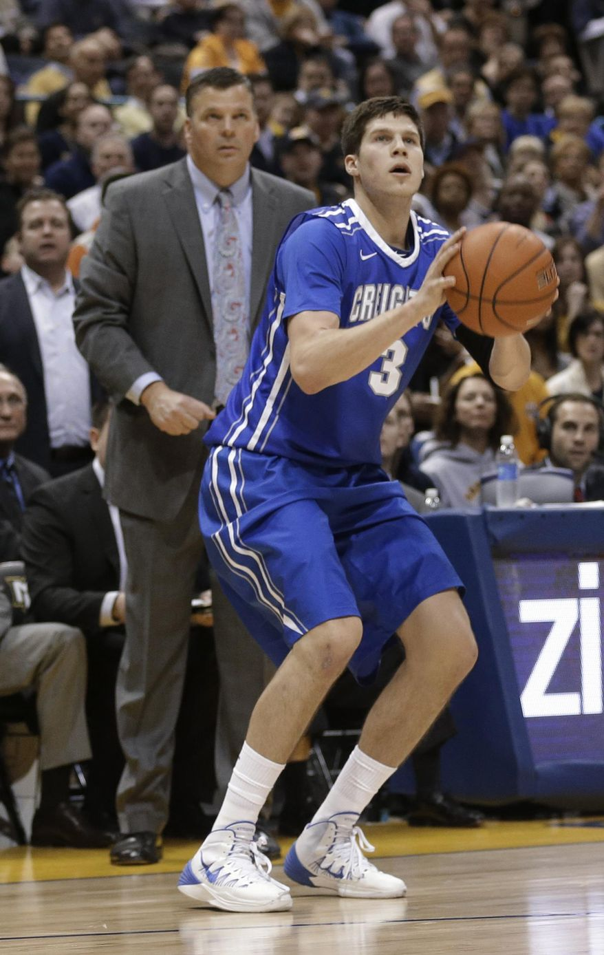 Creighton's Doug McDermott (3) shoots against Marquette as his coach and father, Greg McDermott, watches during the second half of an NCAA college basketball game Wednesday, Feb. 19, 2014, in Milwaukee. Creighton won 85-70. (AP Photo/Jeffrey Phelps)