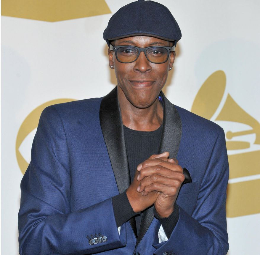** FILE ** In this Dec. 6, 2013, file photo, Arsenio Hall poses backstage at the Grammy Nominations Concert Live! at the Nokia Theatre L.A. Live, in Los Angeles. NBC News anchor Brian Williams made an on-air apology to Hall for leaving him out of a photo gallery of late-night hosts. (Photo by Richard Shotwell/Invision/AP, file)
